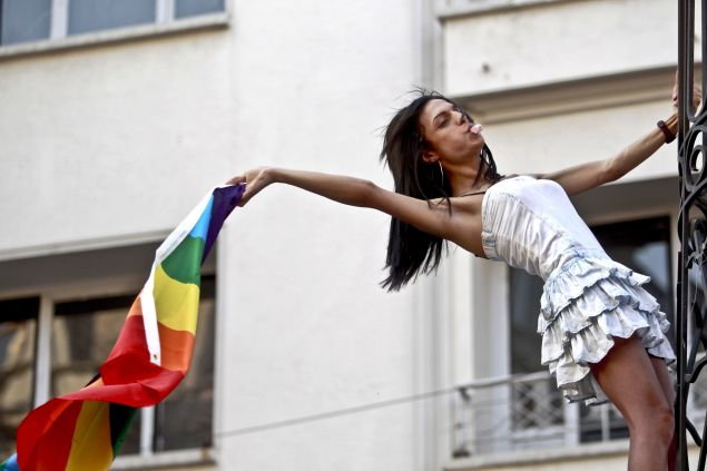 A transsexual waves a gay rainbow flag during the annual Transgender Pride march along Istikbal Avenue in Istanbul, on June 21, 2015.