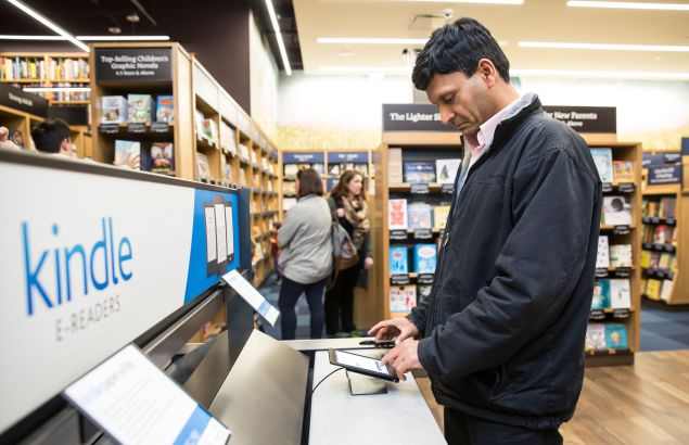 A customer Seattle uses a Kindle table device at the an Amazon facility last November.