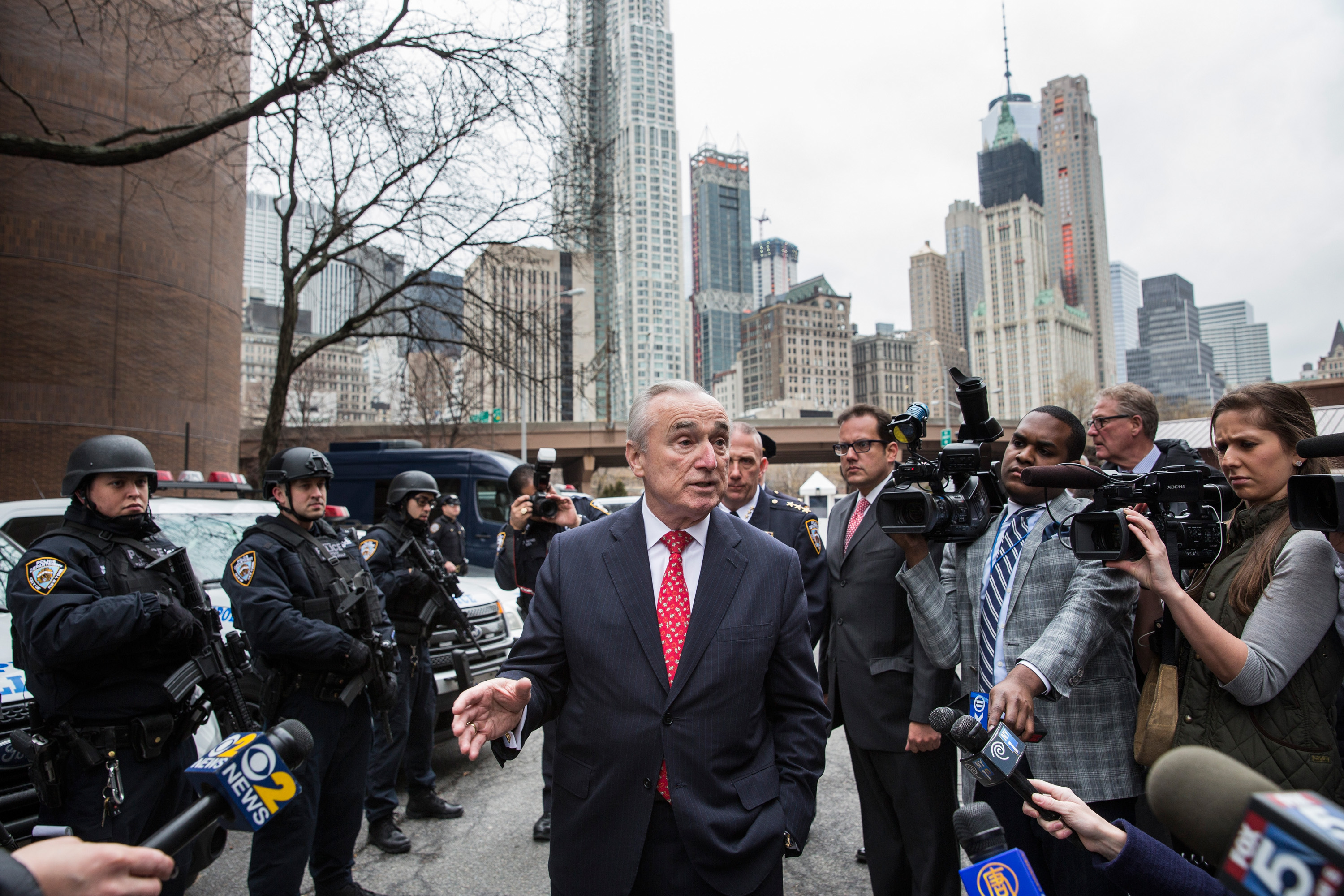 Police Commissioner Bill Bratton with NYPD officers and press.