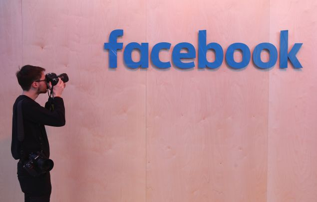 A photographer snaps a photo of the Facebook logo at the Facebook Innovation Hub on February 24, 2016 in Berlin, Germany. The Facebook Innovation Hub is a temporary exhibition space where the company is showcasing some of its newest technologies and projects.
