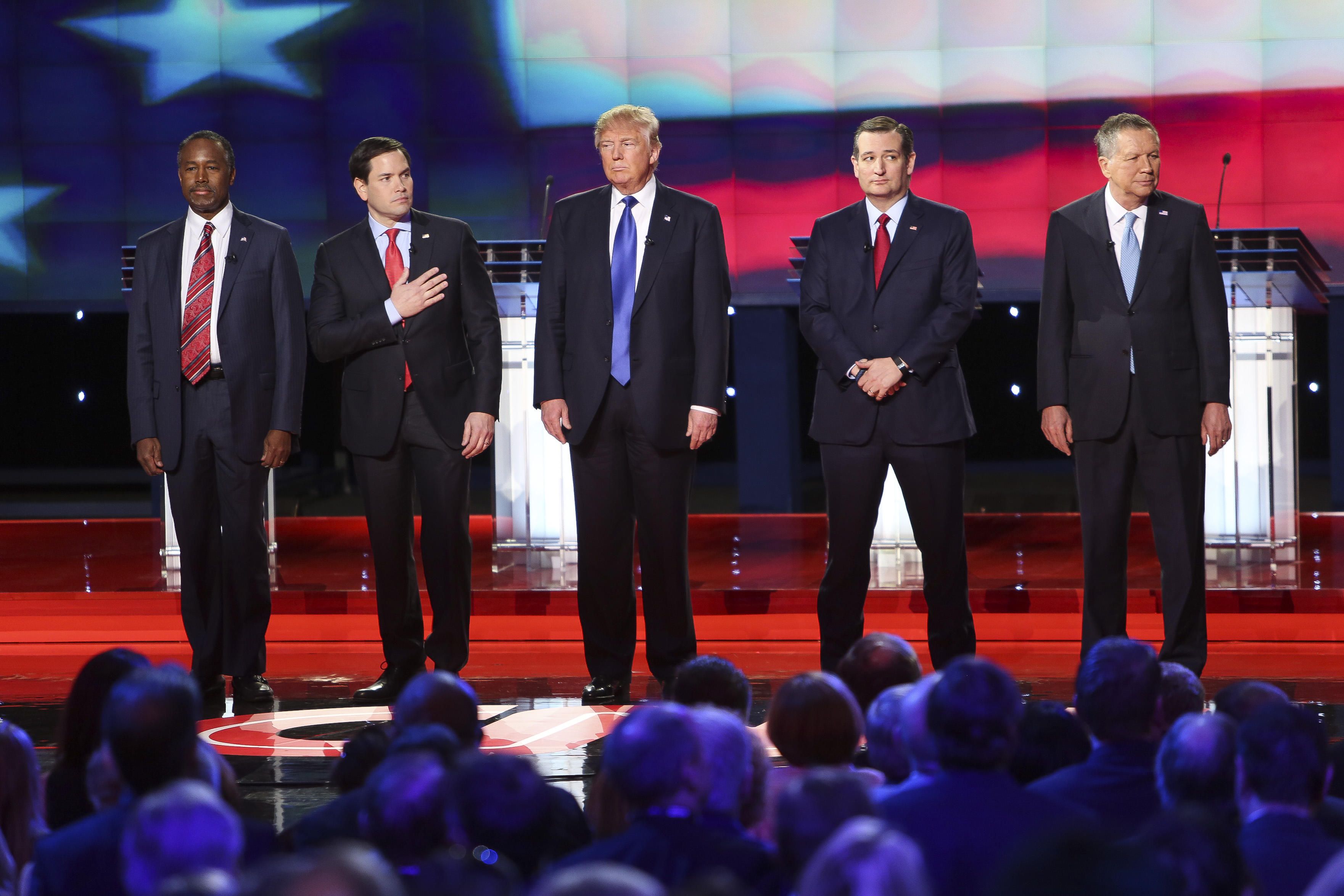 Presidential candidates Marco Rubio, Donald Trump, Ted Cruz and John Kasich and former candidate Ben Carson stand for the national anthem during the Republican Presidential Primary Debate at the University of Houston Thursday, Feb. 25, 2016.