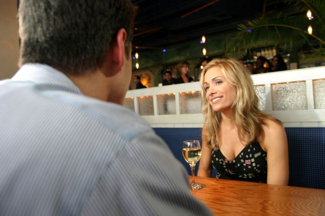 The Bachelorette Jennifer Schefft interviews a Bachelorette contestant at the Pacific Grill on August 13, 2004 in New York City.