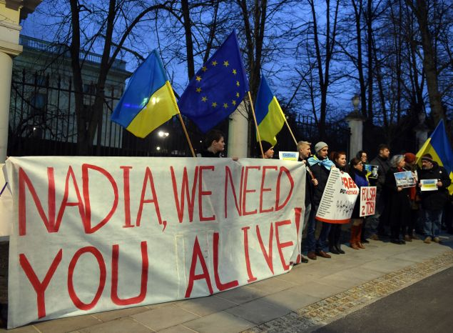 People attend a demonstration in front of Russian embassy in Warsaw in support of Ukrainian pilot Nadiya Savchenko on March 9, 2016. The 34-year-old Iraq war veteran faces up to 23 years in prison if convicted in a case that has drawn global attention and been attended by Western monitors concerned about Russia's record on human rights.