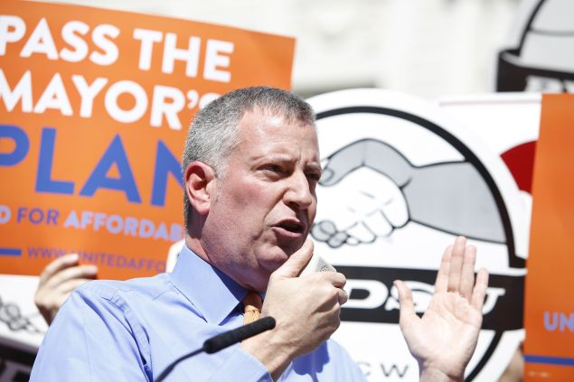 Mayor Bill de Blasio urges adoption of his mandatory inclusionary housing law on City Hall steps. NYC mayor Bill de Blasio highlighted a rally on the city hall steps featuring union and AARP members to urge the city council pass his affordable housing initiative.