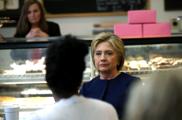 Democratic presidential candidate former Secretary of State Hillary Clinton speaks with local residents at 8 Sisters Bakery on March 13, 2016 in Marion, Ohio. Hillary Clinton is campaigning in Ohio ahead of Tuesday's primary.