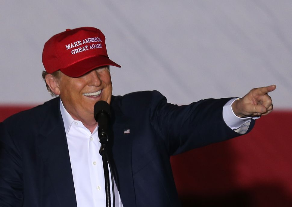 Republican presidential candidate Donald Trump speaks as he attends his campaign rally at the Sunset Cove Amphitheater on March 13, 2016 in Boca Raton, Florida. Trump continues to campaign before the March 15 Florida primary.