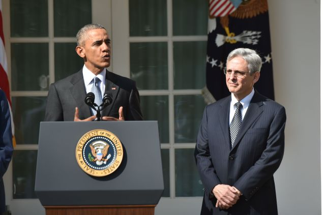 US President Barack Obama announces his Supreme Court nominee, Merrick Garland (R), in the Rose Garden at the White House in Washington, DC, on March 16, 2016. Garland, 63, is currently Chief Judge of the United States Court of Appeals for the District of Columbia Circuit. The nomination sets the stage for an election-year showdown with Republicans who have made it clear they have no intention of holding hearings to vet any Supreme Court nominee put forward by the president.
