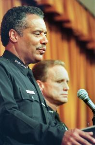 Former LAPD Chief of Police Bernard C. Parks (L) at a 1999 press conference.