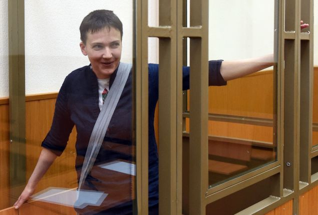 Ukrainian military pilot Nadiya Savchenko looks out from a defendants' cage after the first day of the verdict announcement at a court in the southern Russian town of Donetsk, on March 21, 2016. A Russian court on March 21 began delivering its verdict in the high-profile murder trial of Ukrainian helicopter pilot Nadiya Savchenko, which Kiev and the West have slammed as a political sham. Prosecutors are demanding a 23-year jail term for Savchenko's alleged involvement in the killing of two Russian state TV journalists in war-torn eastern Ukraine in 2014.