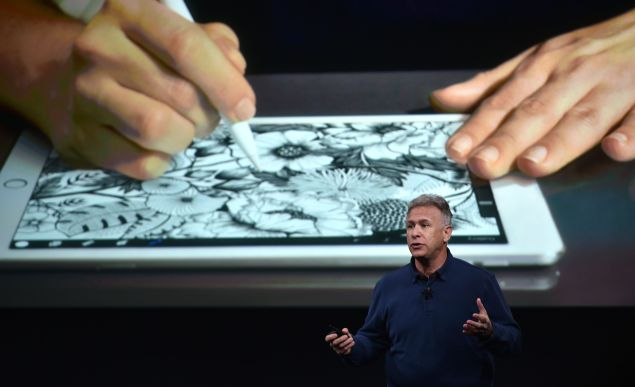 Apple Sr. Vice President of Marketing Phil Schiller introduces the new iPad during a media event at Apple headquarters in Cupertino, California on March 21, 2016.
