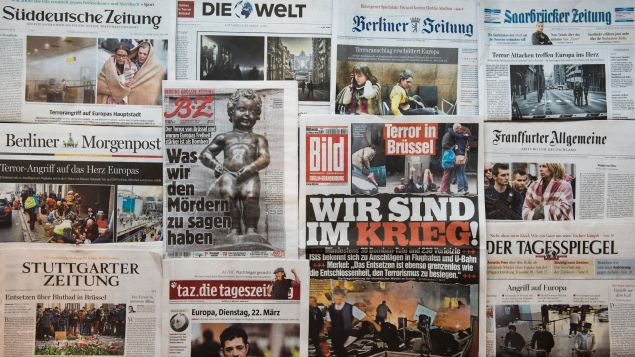 A picture taken on March 23, 2016 in Berlin shows the frontpage of several newspapers, one day after some 35 people were killed in bombings at Zaventem Airport and on a metro train.