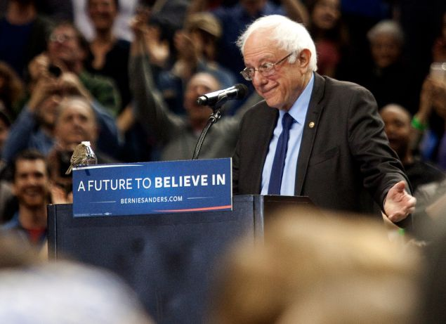 A bird lands on Bernie Sanders's podium as he speaks on Portland, Oregon Friday March 25, 2016. Sanders spoke to a crowd of more than eleven thousand about a wide range of issues, including getting big money out of politics, his plan to make public colleges and universities tuition-free, combating climate change and ensuring universal health care.
