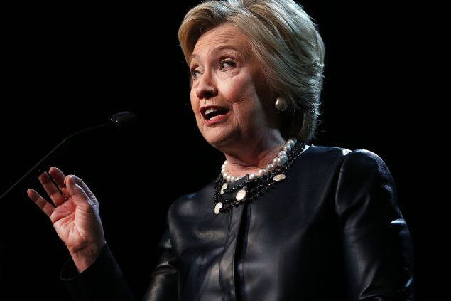 Democratic presidential candidate Hillary Clinton speaks on stage in Harlem at the Apollo Theater on March 30, 2016 in New York City. In a new ad released Wednesday by Clinton, she takes on Republican front-runner Donald Trump. New York will hold its primaries on April 19.