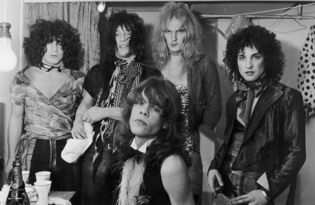 Influential American glam rock band the New York Dolls in their dressing room, 30th October 1972. Standing, left to right: Jerry Nolan, Johnny Thunders, Killer Kane and Sylvain Sylvain. Seated: singer David Johannson.
