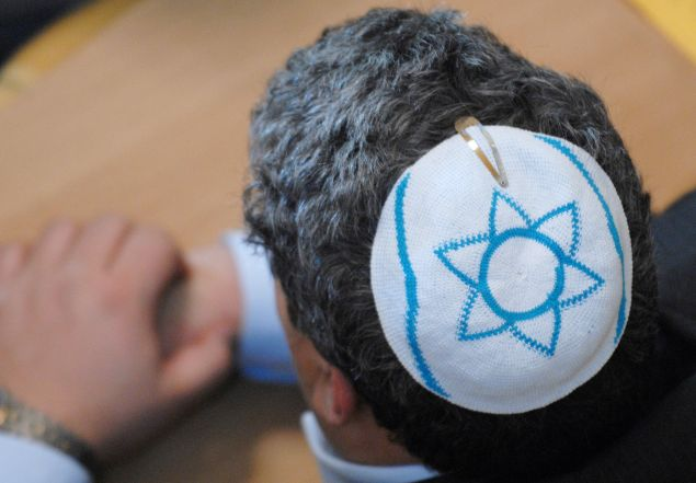 A member of the Jewish community, wearing a kippa.