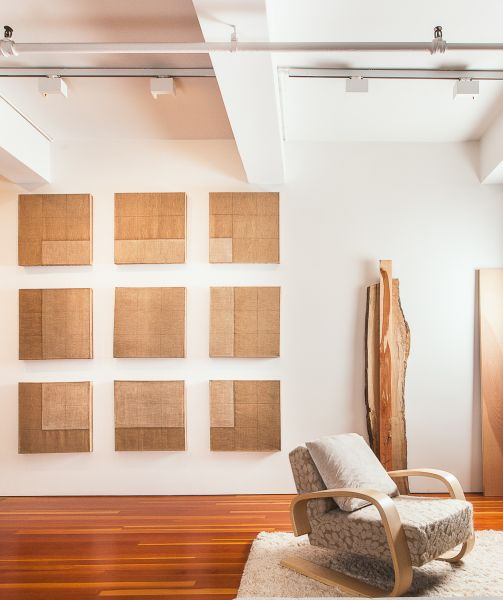 A view of the living room with Adrian Piper, Nine-Part Floating Square, (1967-68) and Virgina Overton, Untitled (overlay), (2013).