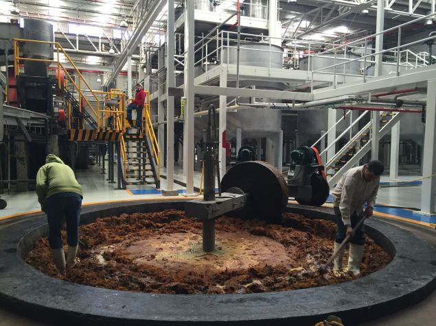 A stone wheel rotates to shred the agave fibers at the Altos distillery in Arandas, Mexico.