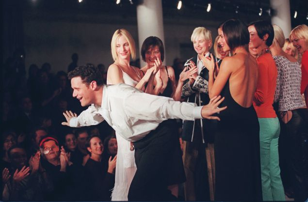 Isaac Mizrahi takes a bow on the runway with his models at the showing of his 1997 Spring collection.