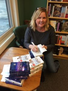Marie Force signing her books.