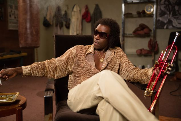 Don Cheadle as Miles Davis.
