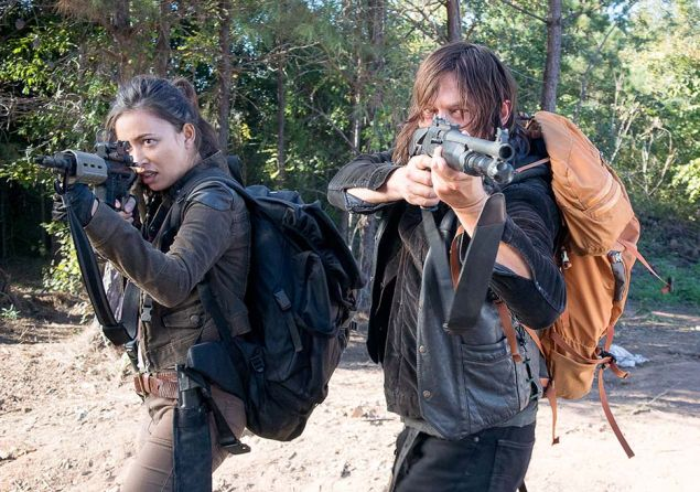 Christian Serratos and Norman Reedus in The Walking Dead.