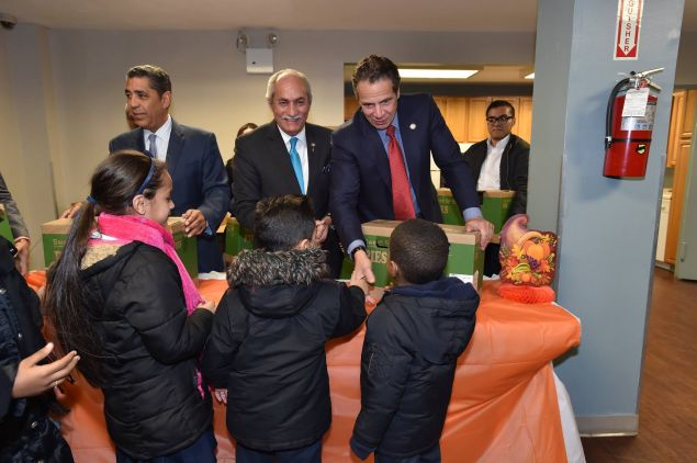 State Senator Adriano Espaillat, left, with Assemblyman Guillermo Linares, center, and Gov. Andrew Cuomo, right.
