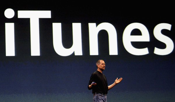 Steve Jobs introduces iTunes.