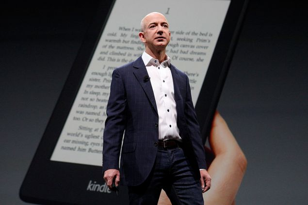 SANTA MONICA, CA - SEPTEMBER 6: Amazon CEO Jeff Bezos unveils new Kindle reading devices during a press conference on September 6, 2012 in Santa Monica, California. Devices include the front-lit Kindle Paperwhite and the Kindle Fire HD in 7 and 8.9-inch sizes.