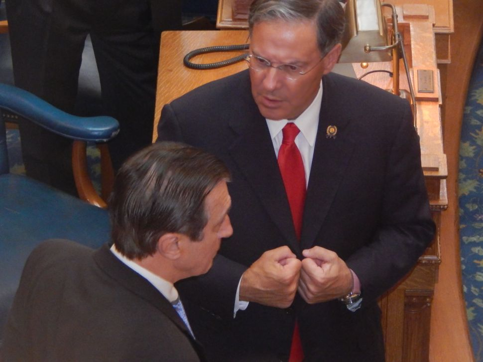 Assembly Minority Leader Jon Bramnick (R-21) finds Assemblyman John Burzichelli (D-3) on the floor of the Assembly Chamber after the Dems' marathon caucus session earlier this summer.