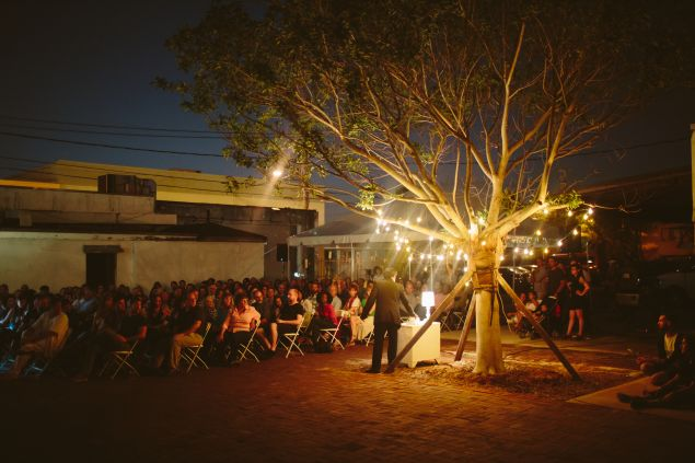 """Verse is light at night in this scene from the """"O, Miami"""" poetry festival."""