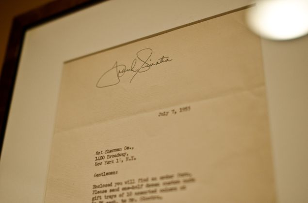 The flagship's walls are lined with memorabilia—from letters signed by Frank Sinatra to snapshots of Nat Sherman himself.
