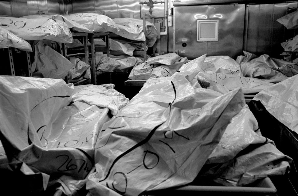 Body bags fill a cooler at the Wayne County morgue; the deceased unclaimed, often due to relativeís inability to pay for a loved oneís burial. Summary: A Detroit Requiem      DetroitÖthe word alone incites many emotions within Americaís conscience.† Detroit was the epicenter for financial equality in the U.S., the home front for the ideal of well-paying jobs for the masses and a political force behind a strong middle class.† Henry Ford made Detroit a boomtown.† Five decades after he started, the boom began to bust.† Many reasons are at the heart of Detroitís decline: postwar industrial policies, urban planning, the 1967 race riots, UAW and auto industry management, Detroitís political cronyism, Clinton era trade deals, and quite possibly the mobility of the automobile itself.† It was the 1950ís when Detroit began the long decay that has brought the city to its present state, a time when Detroit, and America, was at its peak.      Today, Detroit is Americaís poorest large city.† To avoid being the nationís perpetual murder capital, the police began cooking stats.† In 2008, they claimed 306 homicides ñ until The Detroit News discovered that there were actually 375.† In more than 70 percent of murders in Detroit, the killer got away with it.† Detroitís East Side is now the poorest, most violent quarter of Americaís poorest, most violent big city.† The illiteracy, child poverty, and unemployment rates hover around 50 percent.† The shooting death of seven-year-old Aiyana Stanley-Jones by police on Detroitís East Side brought national attention to this quarter over the summer of 2010.† But as the spotlight faded, the killings continued.      With 103 kids and teens murdered in Detroit between January of 2009 and July of 2010, I was sent to cover the failure of political and civil leaders in Detroit, the failure of industry in Detroit, the failure of the federal government in Detroit, the failure of America in Detroit.