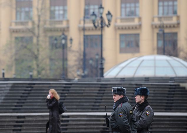 Russian police officers patrol on Manezhnaya Square outside the Kremlin in Moscow on November 9, 2010.