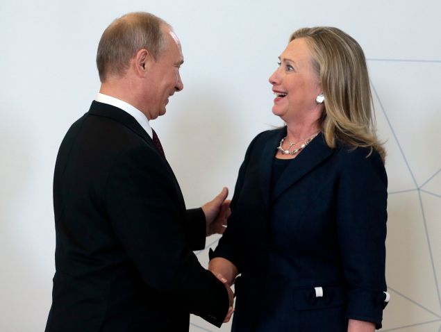 Vladimir Putin welcomes then-Secretary of State Hillary Clinton during the Asia-Pacific Economic Cooperation Summit in Russia in 2012.