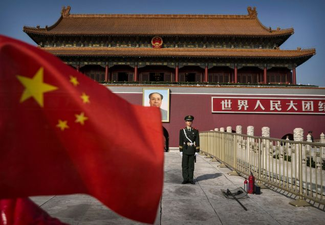 A Chinese soldier stands guard in front of Tiananmen Gate outside the Forbidden City on October 27, 2014 in Beijing, China.