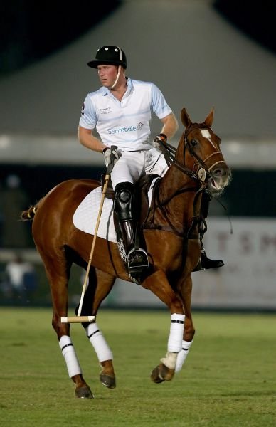 Prince Harry plays during the Sentebale Polo Cup presented by Royal Salute World Polo at Ghantoot Polo Club on November 20, 2014 in Abu Dhabi, United Arab Emirates.
