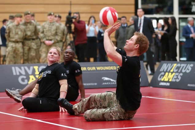 LONDON, ENGLAND - MARCH 06: Prince Harry plays sitting Volley Ball as he takes part in a match at the media launch for the Invictus Games 2014 at the Copper Box Arena in the Olympic Park on March 6, 2014 in London, England. The Invictus Games for wounded, injured and sick serivce personnel will use the power of sport to inspire recovery, support rehabilitation and generate a wider understanding of those who serve the country. Prince Harry has brought the Games to the UK following a trip to see the Warrior Games in Colorado in 2013. 300 competitors from around the world will take part from the 10th-14th September.