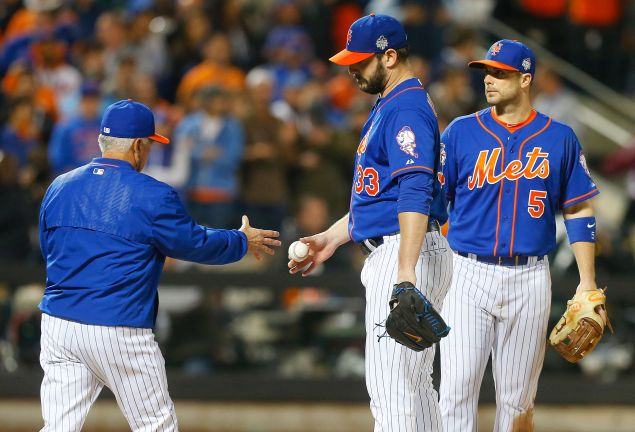 Matt Harvey of the New York Mets hands the ball to manager Terry Collins, as he leaves in the ninth inning against the Kansas City Royals Field in the ninth inning of Game Five of the 2015 World Series.