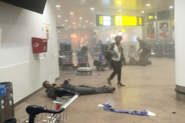 An injured man lies among debris following a suicide bombing at Brussels Zaventem airport last month.