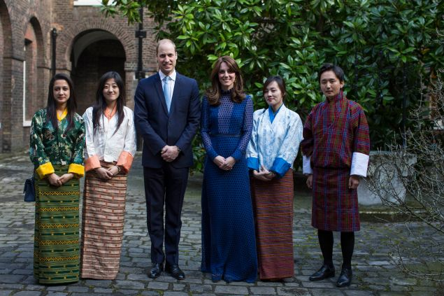 LONDON, ENGLAND - APRIL 6: Prince William, Duke of Cambridge (CL) and Catherine, Duchess of Cambridge (CR) attend a reception ahead of their tour of India and Bhutan at Kensington Palace on April 6, 2016 in London, England.