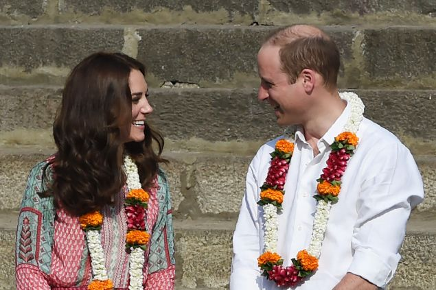 Britain's Prince William (R) and his wife Catherine visit the historic Banganga water tank in Mumbai on April 10, 2016.