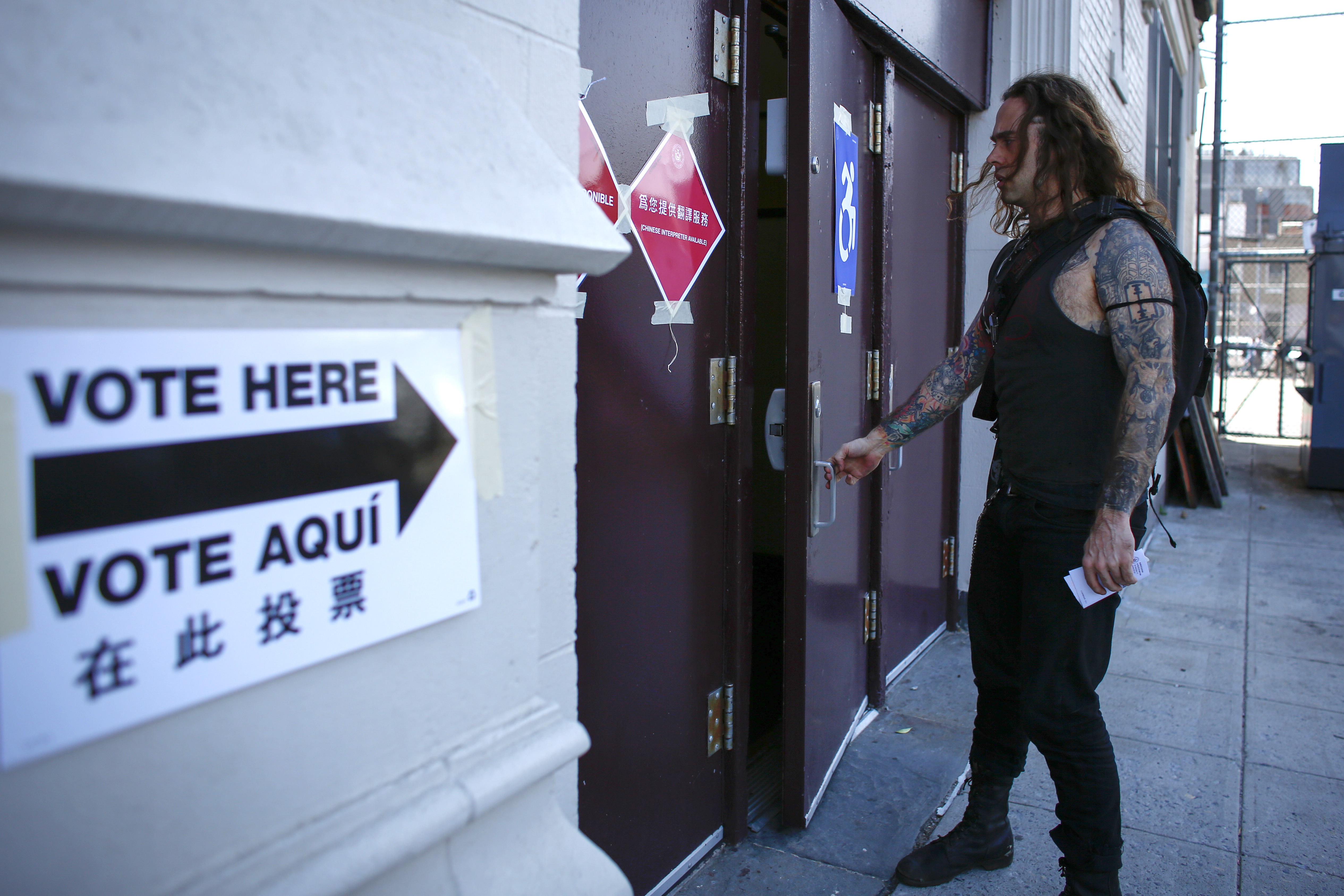 A man arrives at a polling station in Brooklyn, New York during the New York presidential primary April 19, 2016.