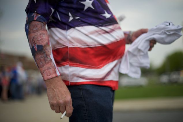 Chris Wolfersberger, 62, smokes a cigarette, with Donald Trump themed socks worn on his forearms, before the Republican presidential hopeful holds a campaign rally at the Pennsylvania Farm Show Complex & Expo Center on April 21, 2016 in Harrisburg, Pennsylvania. The Pennsylvania Primary takes place on April 26.