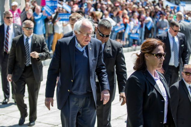 Democratic presidential candidate, U.S. Sen. Bernie Sanders (D-VT) is flanked by his Secret Service detail before greeting supporters following a rally at Roger Williams Park on April 24, 2016 in Providence, Rhode Island. The Rhode Island primary is April 26.