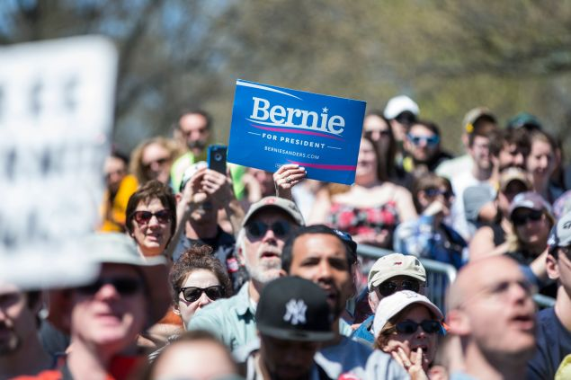 Supporters of Democratic presidential candidate, U.S. Sen. Bernie Sanders (D-VT) watch as he speaks during a rally at Roger Williams Park on April 24, 2016 in Providence, Rhode Island. The Rhode Island primary is April 26.