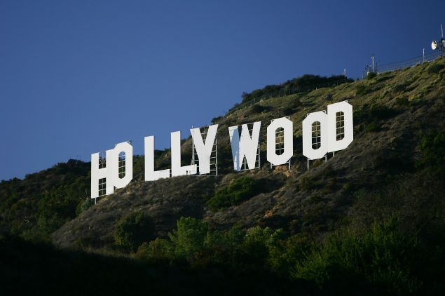 """The Hollywood Sign is seen on November 16, 2005 in Los Angeles, California. The historic landmark is undergoing a month-long makeover; erected in 1923 as a giant ad for a housing development and originally read """"Hollywoodland"""", the sign with letters that are 45 feet tall and 36 feet wide was declared a Los Angeles Cultural Historical Monument in 1973."""