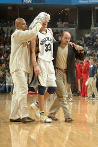 MEMPHIS, TN - NOVEMBER 25: Mike Miller #33 of the Memphis Grizzlies leaves the court after suffering a concussion and a laceration above his left eye during a scramble for the ball in the first quarter of the game against the Houston Rockets on November 25, 2005 at FedExForum in Memphis, Tennessee. The Grizzlies won 86-81. Miller did not return for the rest of the game. NOTE TO USER: User expressly acknowledges and agrees that, by downloading and or using this photograph, User is consenting to the terms and conditions of the Getty Images License Agreement. Mandatory Copyright Notice: Copyright 2005 NBAE