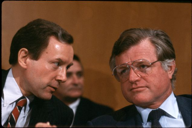 Bipartisan Buds: Sen. Orrin Hatch and Sen. Kennedy share a word in 1982.