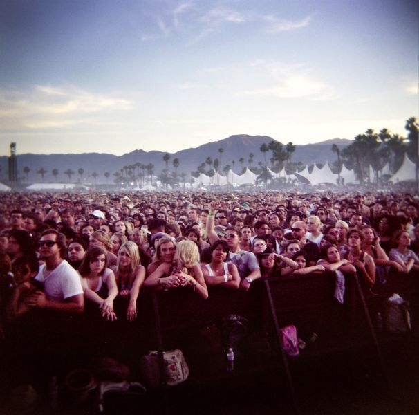 INDIO, CA - APRIL 18: (EDITOR'S NOTE: IMAGE TAKEN WITH A HOLGA CAMERA) Fans take in the music at the Coachella Valley Music and Arts Festival at the Empire Polo Fields on April 18, 2009 in Indio, California. The Coachella Music and Arts Festival has attracted thousands of attendees to the Coachella Valley since 1999.
