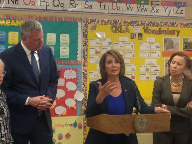 Minority Leader Pelosi, flanked by Mayor Bill de Blasio and Congresswoman Nydia Velazquez.